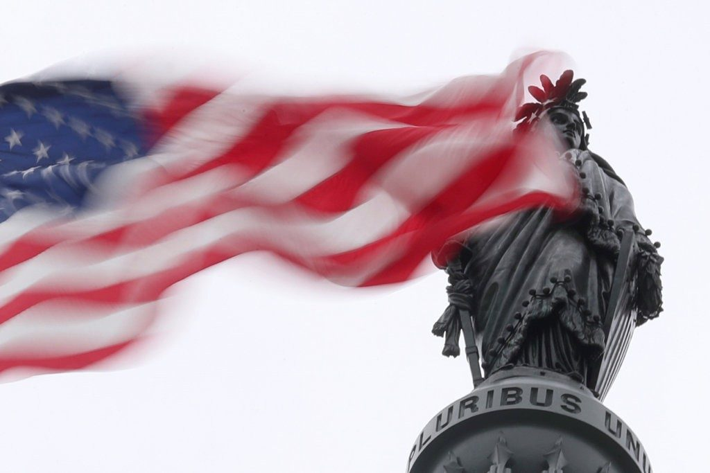 Flag flying over statue of freedom